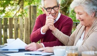 Older couple reviewing documents happily