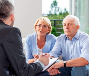 Older couple speaking with a lawyer