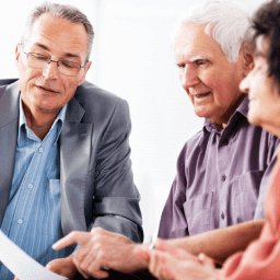 Lawyer explaining options to older couple