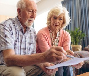 Older couple reviewing medical records