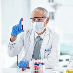 Doctor analyzing a vial of blood