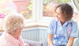 Nurse speaking with an older woman