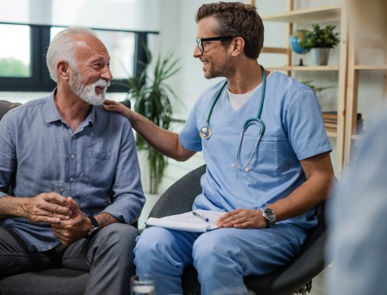 Older man talking with a cancer specialist