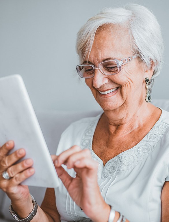 Senior woman reviewing medical information on a tablet device