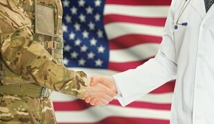 doctor and veteran shaking hands